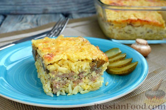 Фото к рецепту: Рисовая запеканка с мясным фаршем, грибами и сливками