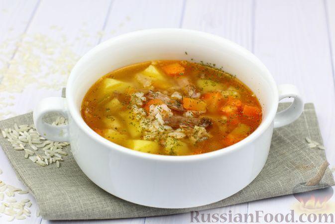 Фото к рецепту: Картофельный суп с тушёнкой и рисом