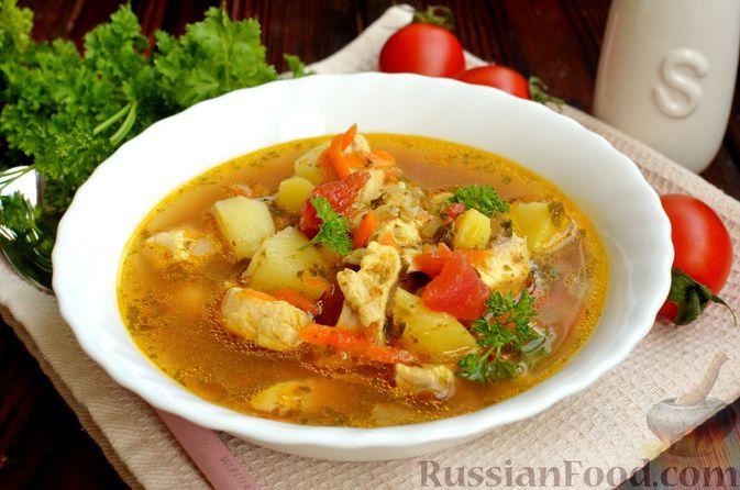 Фото к рецепту: Рыбный суп с помидорами и шпинатом