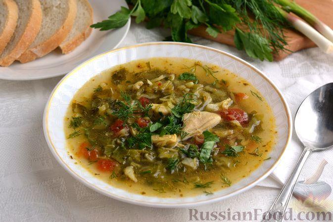Фото к рецепту: Куриный суп с молодой капустой и шпинатом
