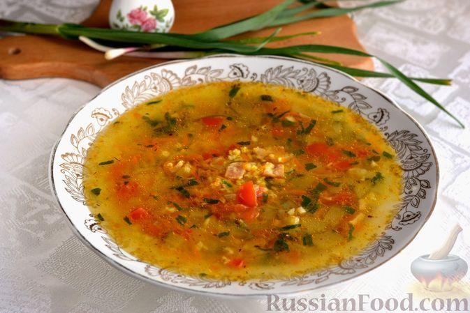 Фото к рецепту: Куриный суп с пшеном, кабачками и ветчиной