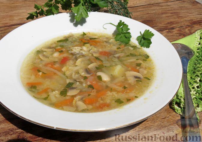 Фото к рецепту: Куриный суп с фасолью, грибами, капустой и пшеном
