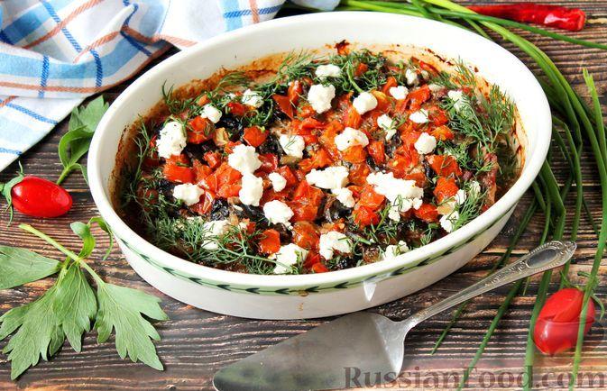 Фото к рецепту: Свинина, запечённая с грибами, помидорами и сыром фета