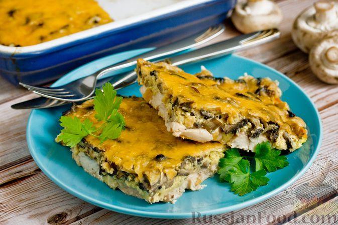Фото к рецепту: Куриная запеканка с грибами и сыром