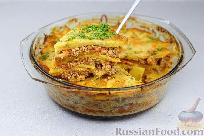 Фото к рецепту: Картофельная запеканка с фаршем и соусом бешамель