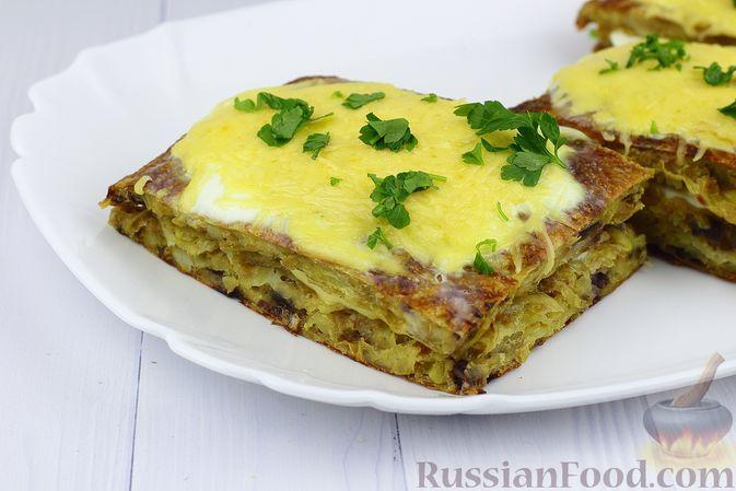 Фото к рецепту: Картофельная запеканка с фаршем и сыром