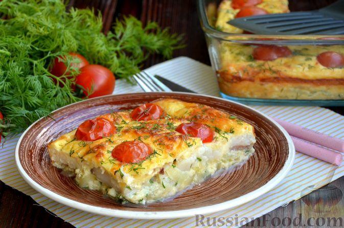 Фото к рецепту: Рыбная запеканка с помидорами и сыром