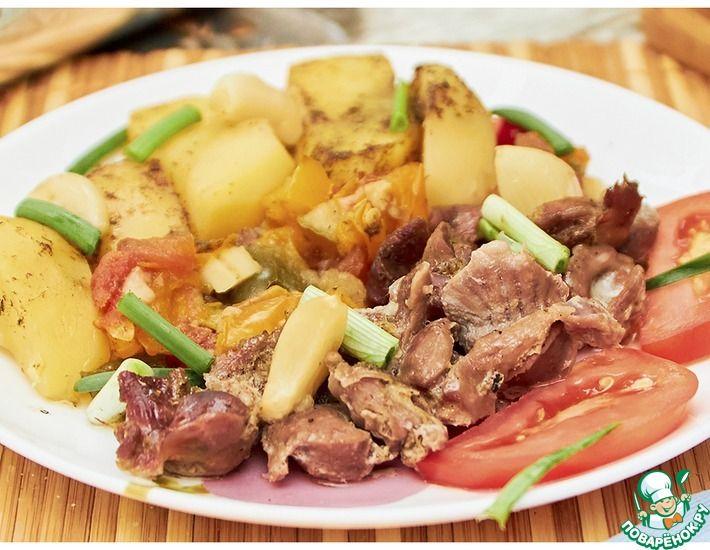 Рецепт: Куриные желудочки с овощами в духовке