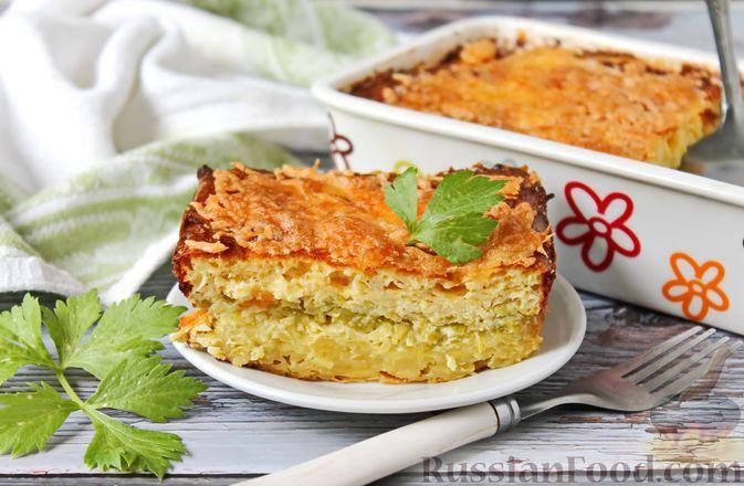 Фото к рецепту: Картофельная запеканка с кабачками, творогом и сыром