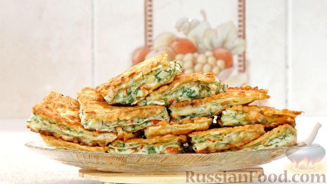 Фото к рецепту: Закуска из лаваша и крабовых палочек