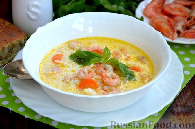 Фото к рецепту: Сырный суп с креветками и рисом