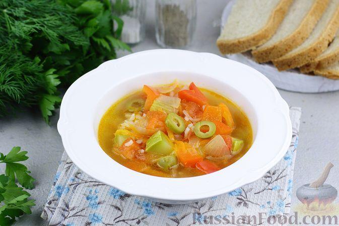 Фото к рецепту: Овощной суп с рисом и оливками