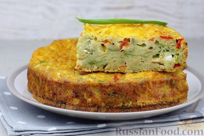Фото к рецепту: Закусочный пирог с картофелем, помидорами, болгарским перцем и сыром