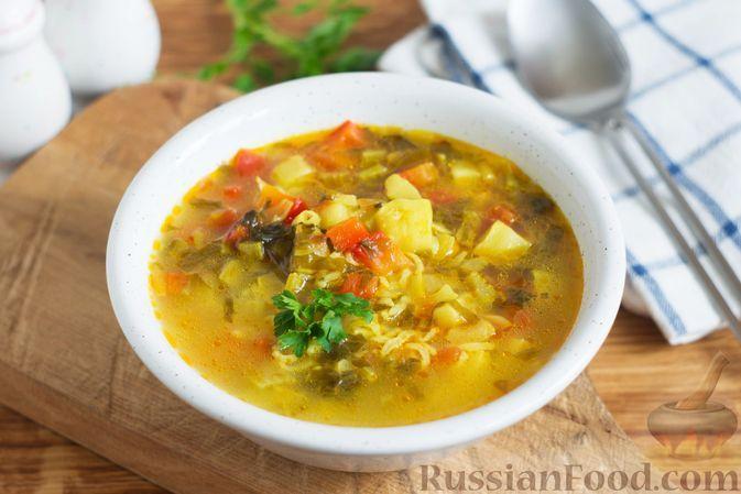 Фото к рецепту: Рисовый суп со щавелем, кабачком и помидорами