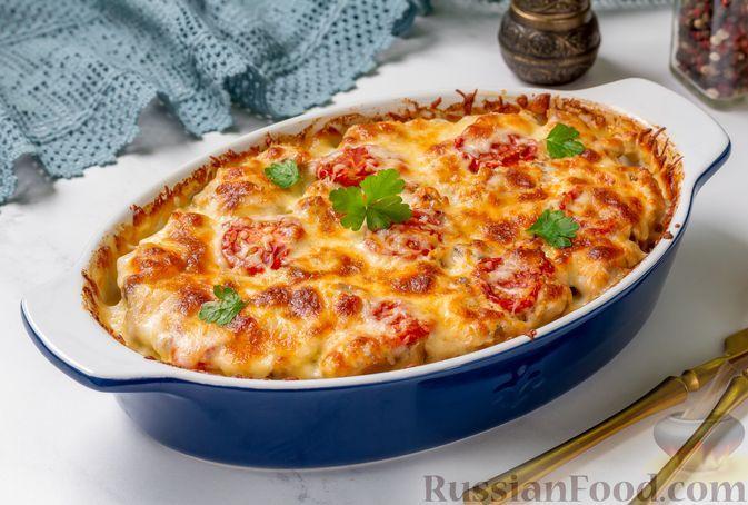 Фото к рецепту: Картофельная запеканка со свининой, помидорами и луком