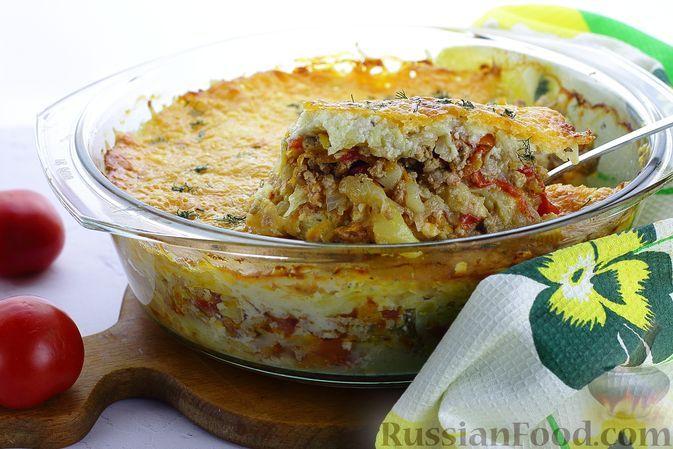 Фото к рецепту: Картофельная запеканка с фаршем, помидорами и сыром