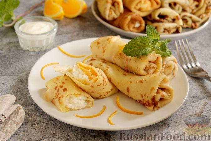 Фото к рецепту: Апельсиновые блины с творогом