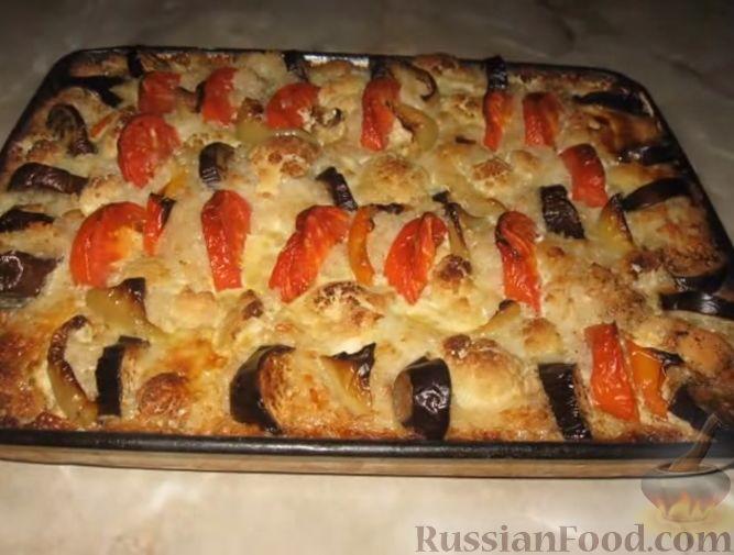 Фото к рецепту: Запеканка рисовая с куриной грудкой и овощами