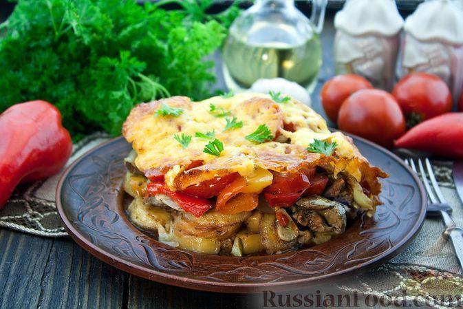Фото к рецепту: Куриная печень, запечённая с овощами, под сыром