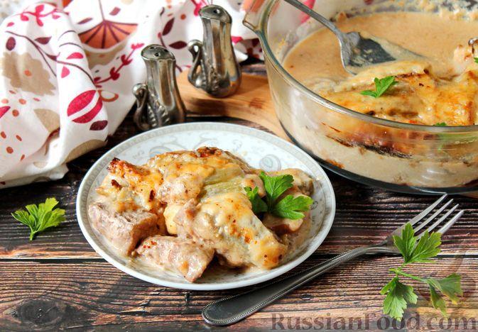 Фото к рецепту: Свинина, запечённая с баклажанами и сыром