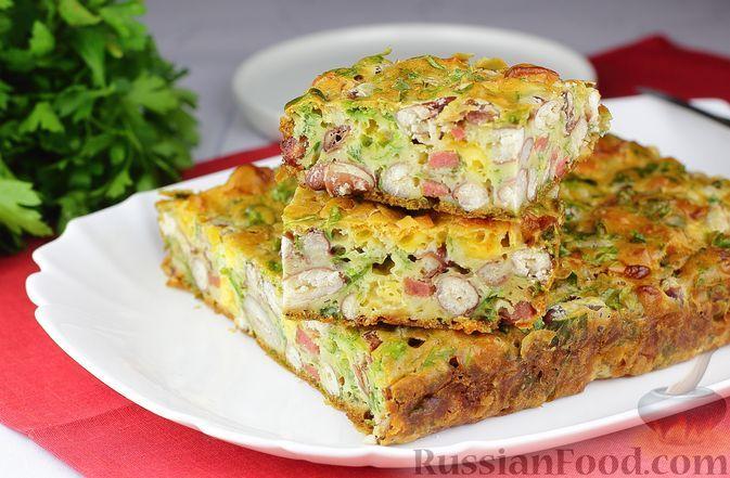 Фото к рецепту: Запеканка с консервированной фасолью, колбасой и сыром