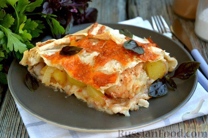 Фото к рецепту: Куриные голени, запечённые с картофелем, в лаваше