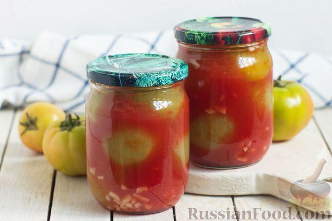 Фото к рецепту: Консервированные зелёные помидоры в томатном соке, с чесноком