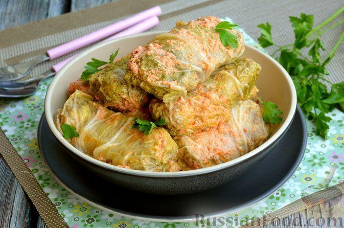 Фото к рецепту: Голубцы из пекинской капусты с фаршем из куриных сердечек и филе