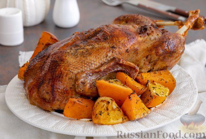 Фото к рецепту: Утка с тыквой и апельсинами, в духовке